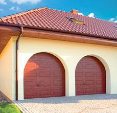 A sectional garage door with an arch shaped head